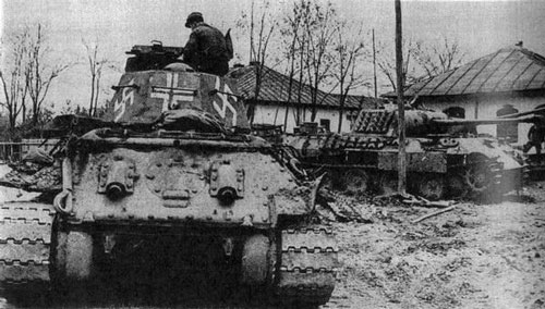 T-34 mod 1942/43 using a German Cross on the rear panel of the turret & Swastikas on the sides (Rear sections) of the turret of the tank.