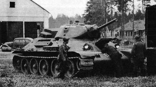 T-34 mod 1941/42 with some writing on the side (Front section) of the turret, and on the front panel of the tank.