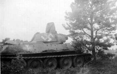 T-34 mod 1941/42 with some writing on the side (Front section) of the turret & on the side (Rear section) of the tank. (In the middle of the German Cross).