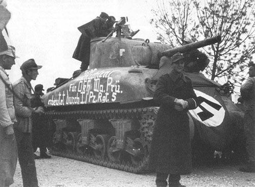 "M4 Sherman with some writing on the side (Mid section) of the tank. ""Für OKH, Prü erbeutet durch I. / Pz.Rgt.5"" ""For OKH, Examination. Captured by I. / Pz.Rgt.5"""