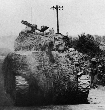 Heavily camouflaged Sherman