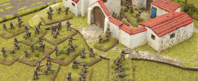 The Assault Platoon advance with the Company Commander on one flank...