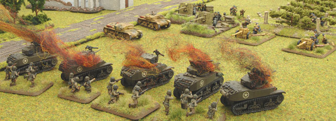 The I&R platoon take up positions behind the destroyed Stuarts.