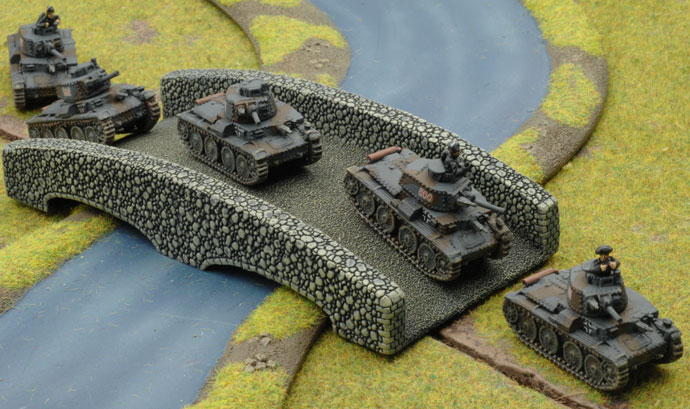 The German Panzers advance across the river