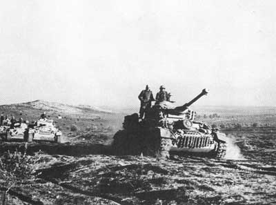 Panzer IV Gs advancing across the rough Tunisian terrain
