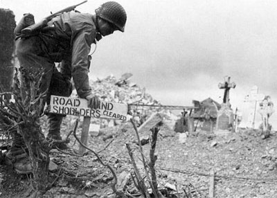 2nd Division engineer marks a mine cleared road