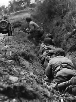 US Riflemen use a ditch for cover
