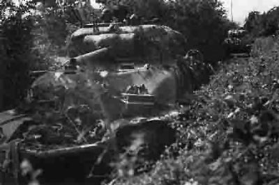 Shermans advance down a bocage lined lane