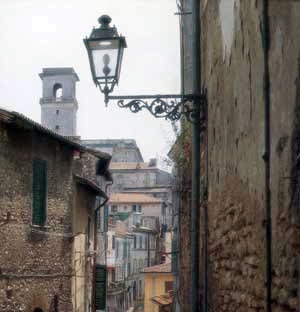 A view down one of the narrow streets of Monterotondo of Orsini Castle's tower.