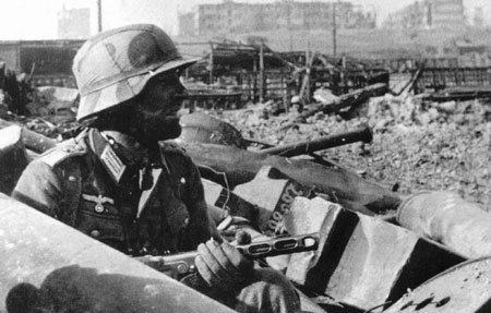 German soldier in the rubble of the Stalingrad rail yards