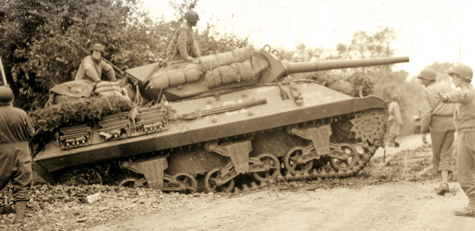 "An M10 3"" GMC Tank Destroyer navigates the hedgerows of Normandy."