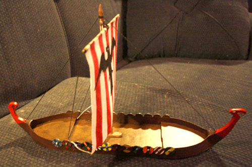 Viking long ship with hand painted sails by Mike Paine