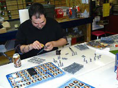 One of the Thursday Night Regulars at Adler Hobbies in Hollis, New Hampshire assembles his Vikings war band!