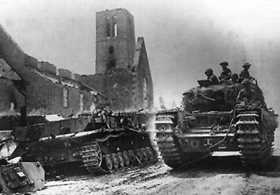 A Churchill IV passes a bombed out church