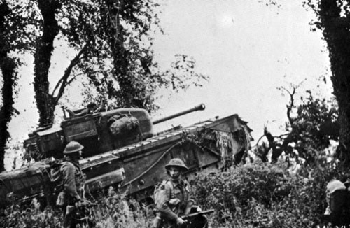 Churchill VI advancing across the bocage