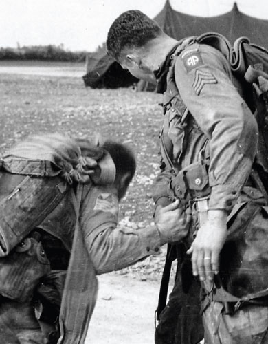 American paratroopers check their gear
